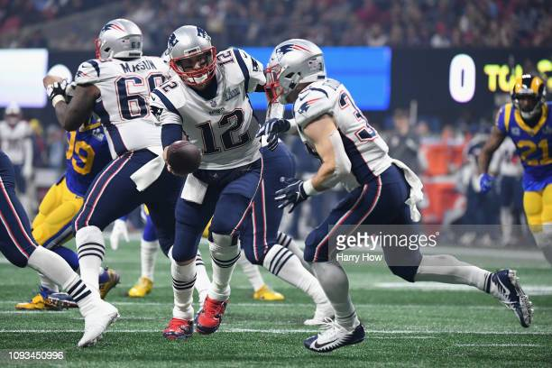 Tom Brady of the New England Patriots hands the ball of to Rex Burkhead in the second half during Super Bowl LIII against the Los Angeles Rams at...
