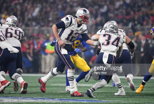 Tom Brady of the New England Patriots hands the ball of to Rex Burkhead of the New England Patriots in the second half during Super Bowl LIII at...