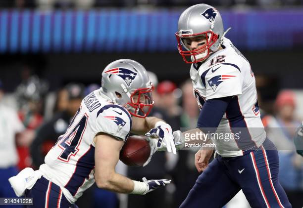 Tom Brady of the New England Patriots hands the ball off to Rex Burkhead against the Philadelphia Eagles during the fourth quarter in Super Bowl LII...