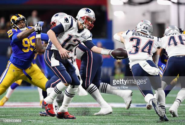 Tom Brady of the New England Patriots hands the ball offsides to Rex Burkhead of the New England Patriots in the first half during Super Bowl LIII...
