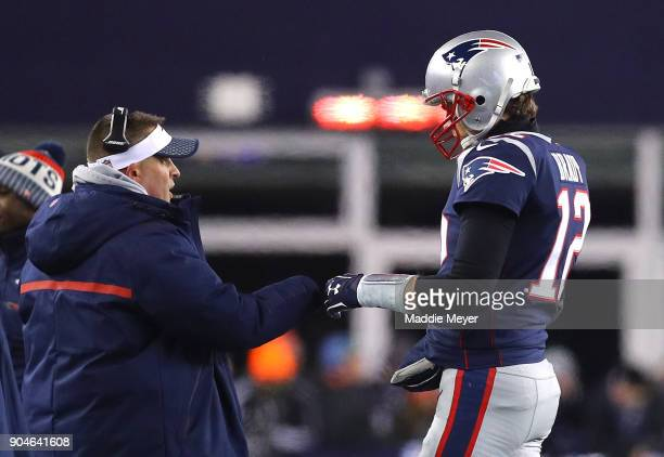 Tom Brady of the New England Patriots high fives offensive coordinator Josh McDaniels in the second quarter of the AFC Divisional Playoff game...