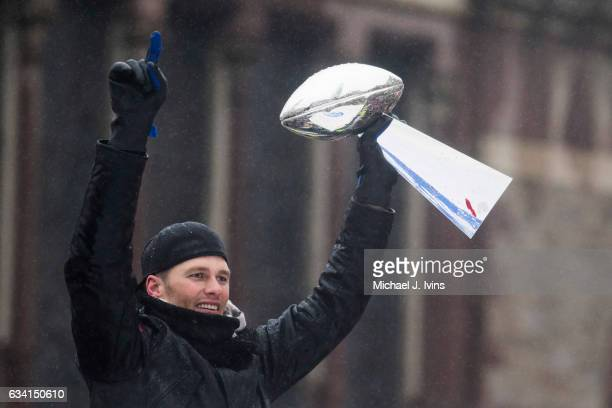Tom Brady of the New England Patriots hoists the Vince Lombardi Trophy during a Super Bowl victory parade on February 7 2017 in Boston Massachusetts...