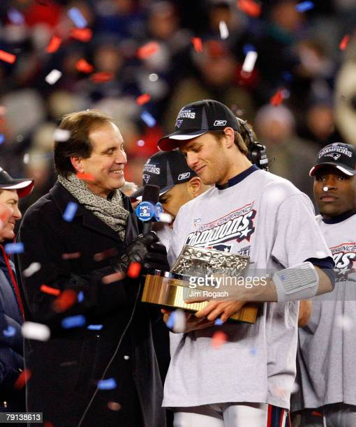 Tom Brady of the New England Patriots holds the Lamar Hunt Trophy as he talks to Jim Nantz after defeating the San Diego Chargers by a score of 2112...