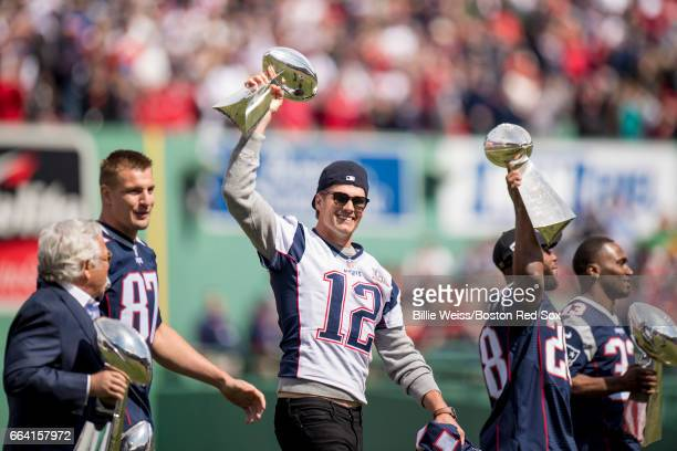 Tom Brady of the New England Patriots holds the Super Bowl trophy alongside Owner Robert Kraft Rob Gronkowski James White and Dion Lewis during a...