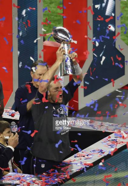 Tom Brady of the New England Patriots holds the Vince Lombardi trophy after the Patriots defeat the Atlanta Falcons 3428 in overtime of Super Bowl 51...