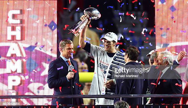Tom Brady of the New England Patriots holds the Vince Lombardi Tropy after winning Super Bowl XLIX over the Seattle Seahawks 2824 at University of...