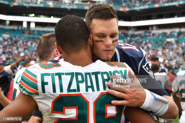 Tom Brady of the New England Patriots hugs Minkah Fitzpatrick of the Miami Dolphins after the game at Hard Rock Stadium on September 15 2019 in Miami...