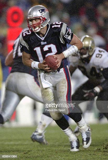 Tom Brady of the New England Patriots in action against the New Orleans Saints during an NFL football game November 25 2001 at Foxboro Stadium in...
