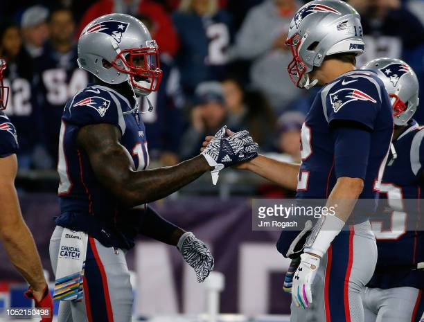 Tom Brady of the New England Patriots interacts with Josh Gordon of the New England Patriots before a game with the Kansas City Chiefs at Gillette...