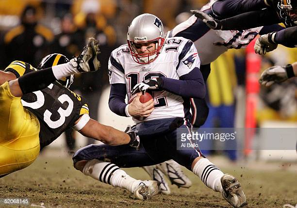 Tom Brady of the New England Patriots is brought down under pressure from Clark Haggans of the Pittsburgh Steelers in the AFC championship game at...
