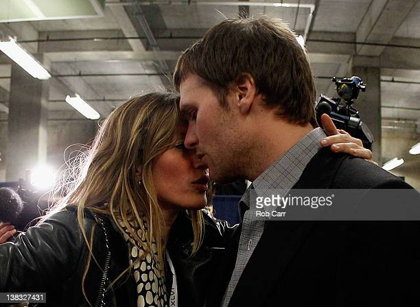 Tom Brady of the New England Patriots is comforted by his wife Gisele Bundchen after losing to the New York Giants by a score of 2117 in Super Bowl...