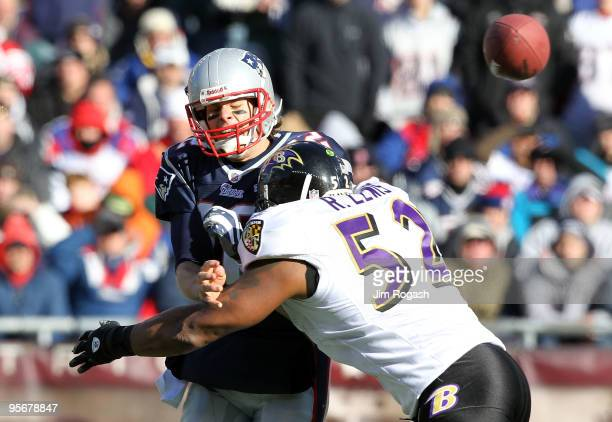 Tom Brady of the New England Patriots is hit as he throws the ball by Ray Lewis of the Baltimore Ravens during the 2010 AFC wildcard playoff game at...