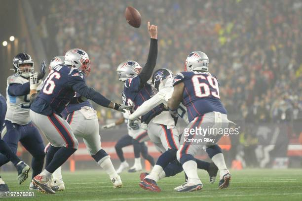 Tom Brady of the New England Patriots is hit as they take on the Tennessee Titans in the first half of the AFC Wild Card Playoff game at Gillette...