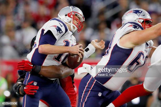 Tom Brady of the New England Patriots is hit in the first quarter against the Atlanta Falcons during Super Bowl 51 at NRG Stadium on February 5 2017...