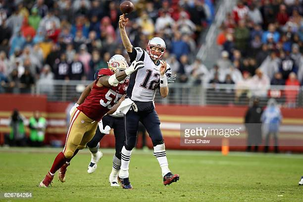 Tom Brady of the New England Patriots is pressured by Ahmad Brooks of the San Francisco 49ers at Levi's Stadium on November 20 2016 in Santa Clara...