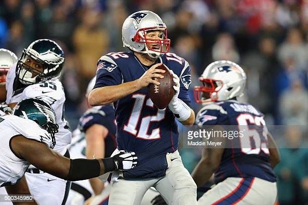 Tom Brady of the New England Patriots is pressured in the pocket against the Philadelphia Eagles at Gillette Stadium on December 6 2015 in Foxboro...