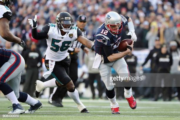 Tom Brady of the New England Patriots is pursued by Dante Fowler Jr #56 of the Jacksonville Jaguars in the first quarter during the AFC Championship...