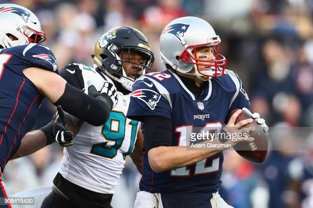 Tom Brady of the New England Patriots is pursued by Yannick Ngakoue of the Jacksonville Jaguars in the second quarter during the AFC Championship...