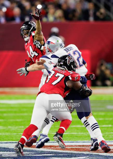 Tom Brady of the New England Patriots is sacked by Grady Jarrett of the Atlanta Falcons in the first quarter during Super Bowl 51 at NRG Stadium on...