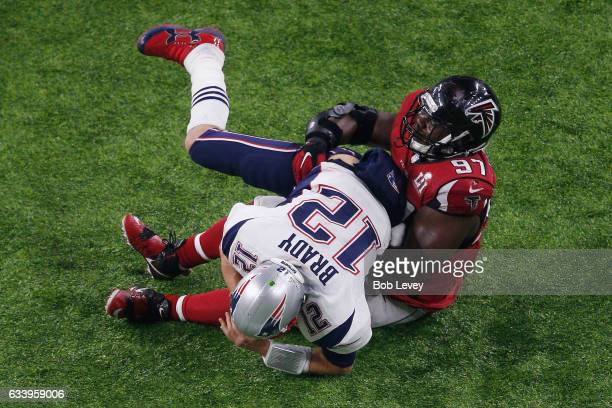 Tom Brady of the New England Patriots is sacked by Grady Jarrett of the Atlanta Falcons during Super Bowl 51 at NRG Stadium on February 5 2017 in...