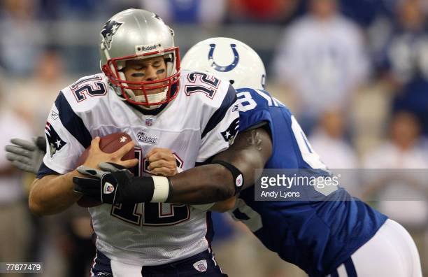 Tom Brady of the New England Patriots is sacked by Robert Mathis of the Indianapolis Colts on November 4 2007 at the RCA Dome in Indianapolis Indiana