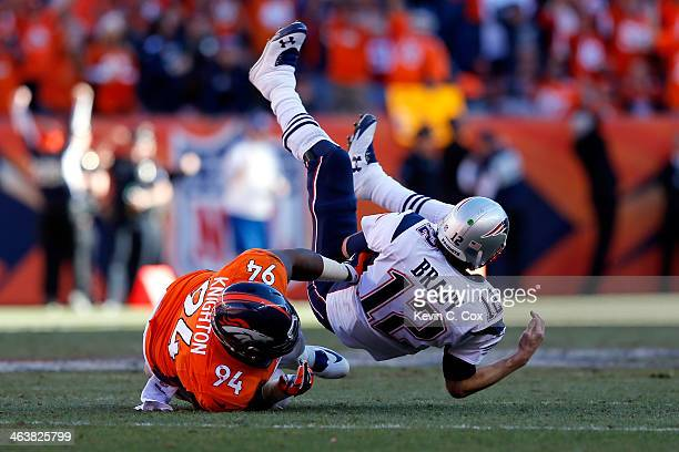 Tom Brady of the New England Patriots is sacked by Terrance Knighton of the Denver Broncos in the fourth quarter during the AFC Championship game at...
