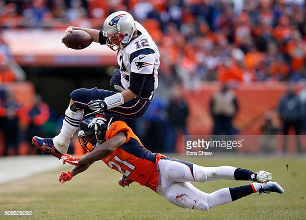 Tom Brady of the New England Patriots is tackled by Aqib Talib of the Denver Broncos after an 11 yard scramble in the second quarter in the AFC...