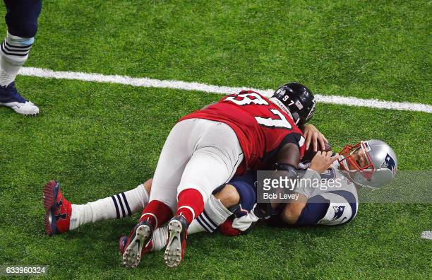 Tom Brady of the New England Patriots is tackled by Grady Jarrett of the Atlanta Falcons during the fourth quarter during Super Bowl 51 at NRG...