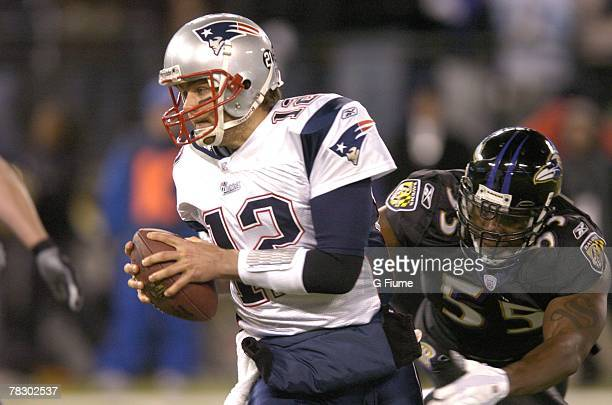 Tom Brady of the New England Patriots is tackled by Terrell Suggs of the Baltimore Ravens on December 3 2007 at MT Bank Stadium in Baltimore Maryland