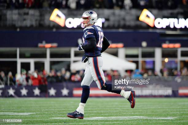 Tom Brady of the New England Patriots jogs on the field during the first half against the Buffalo Bills in the game at Gillette Stadium on December...