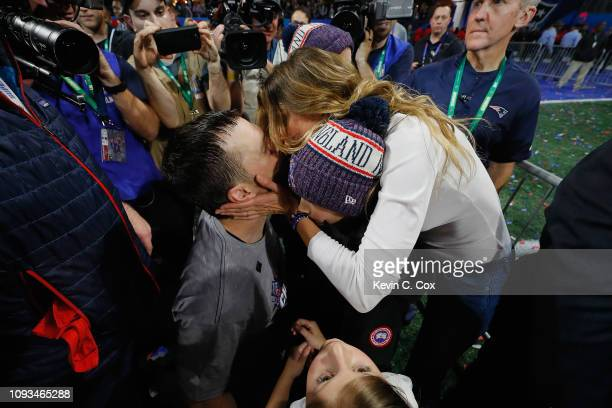 Tom Brady of the New England Patriots kisses his wife Gisele Bundchen after the Patriots defeat the Los Angeles Rams 133 during Super Bowl LIII at...