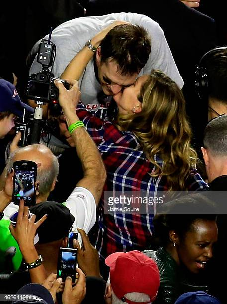 Tom Brady of the New England Patriots kisses his wife Gisele Bundchen after defeating the Seattle Seahawks during Super Bowl XLIX at University of...