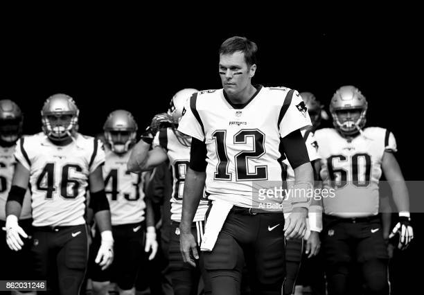 Tom Brady of the New England Patriots leads his team onto the field against the New York Jets before their game at MetLife Stadium on October 15 2017...