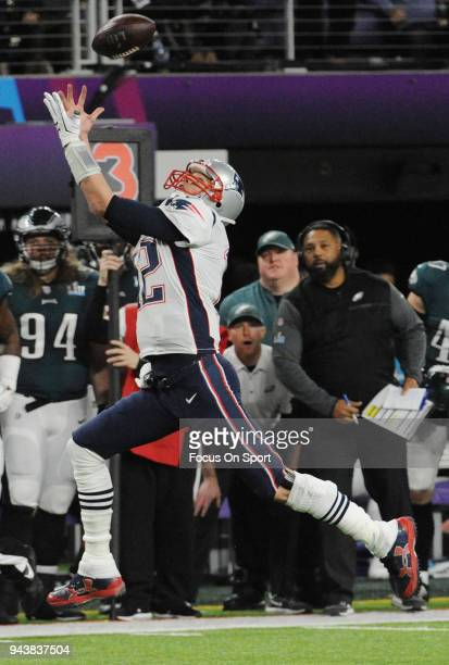 Tom Brady of the New England Patriots leaps for a pass against the Philadelphia Eagles during Super Bowl LII at US Bank Stadium on February 4 2018 in...