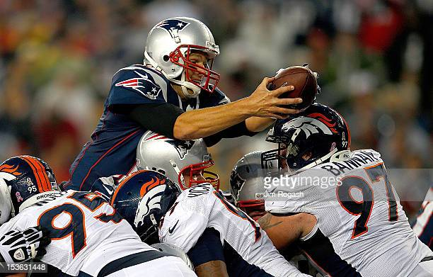 Tom Brady of the New England Patriots leaps in for a touchdown in the third quarter during a game with the New England Patriots at Gillette Stadium...
