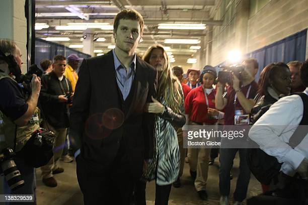 Tom Brady of the New England Patriots leaves the stadium with his wife Gisele Bundchen after losing to the New York Giants by a score of 2117 in...