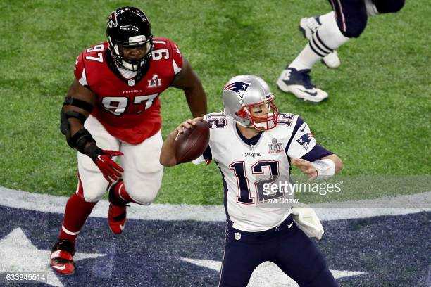 Tom Brady of the New England Patriots looks for a pass with pressure from Grady Jarrett of the Atlanta Falcons during the first quarter of Super Bowl...