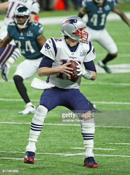 Tom Brady of the New England Patriots looks for a receiver against the Philadelphia Eagles during Super Bowl Lll at US Bank Stadium on February 4...