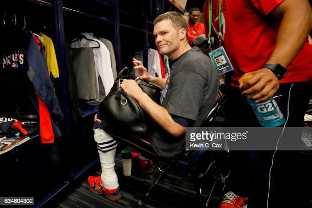 Tom Brady of the New England Patriots looks for his missing jersey in the locker room after defeating the Atlanta Falcons during Super Bowl 51 at NRG...