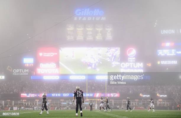Tom Brady of the New England Patriots looks on as fog falls on the field during the fourth quarter of a game against the Atlanta Falcons at Gillette...