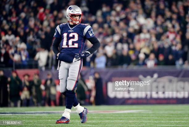 Tom Brady of the New England Patriots looks on during the first half against the Buffalo Bills in the game at Gillette Stadium on December 21 2019 in...