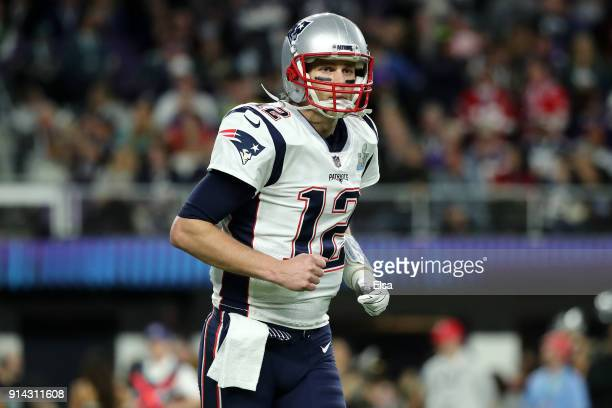 Tom Brady of the New England Patriots looks on the first half of Super Bowl LII against the Philadelphia Eagles at U.S. Bank Stadium on February 4,...