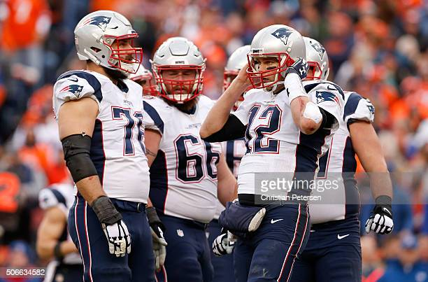 Tom Brady of the New England Patriots looks on with his team in the second half against the Denver Broncos in the AFC Championship game at Sports...