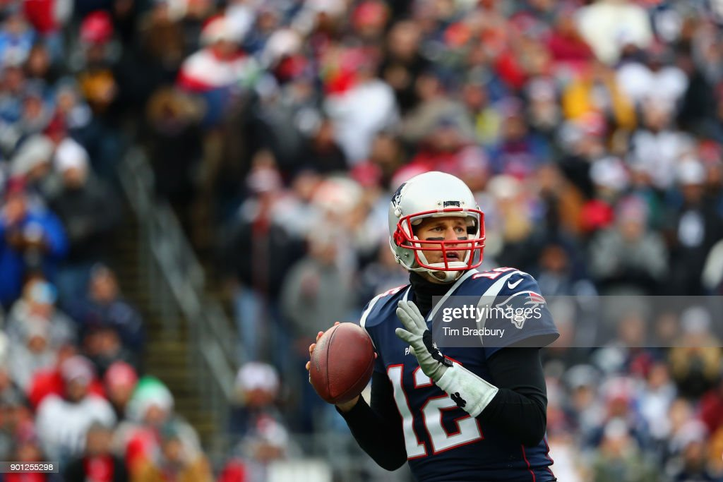 Tom Brady #12 of the New England Patriots looks to pass against the Buffalo Bills at Gillette Stadium on December 24, 2017 in Foxboro, Massachusetts.
