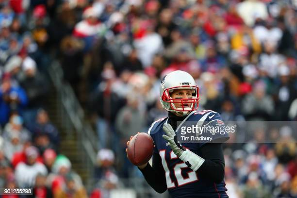 Tom Brady of the New England Patriots looks to pass against the Buffalo Bills at Gillette Stadium on December 24 2017 in Foxboro Massachusetts