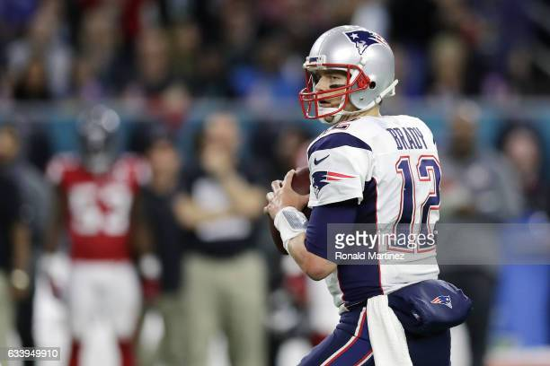 Tom Brady of the New England Patriots looks to pass against the Atlanta Falcons during the first quarter during Super Bowl 51 at NRG Stadium on...