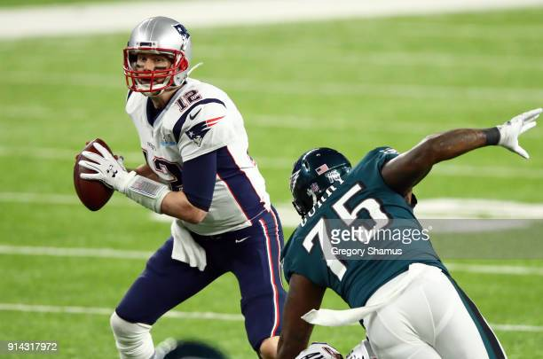 Tom Brady of the New England Patriots looks to pass against Vinny Curry of the Philadelphia Eagles during the second quarter in Super Bowl LII at US...