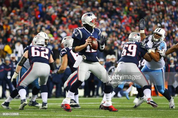 Tom Brady of the New England Patriots looks to pass during the AFC Divisional Playoff game against the Tennessee Titans at Gillette Stadium on...