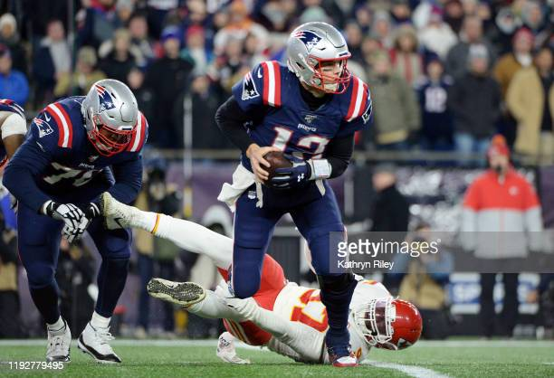 Tom Brady of the New England Patriots looks to pass during the first half against the Kansas City Chiefs in the game at Gillette Stadium on December...