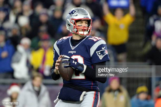 Tom Brady of the New England Patriots looks to pass during the first half against the Buffalo Bills in the game at Gillette Stadium on December 21...